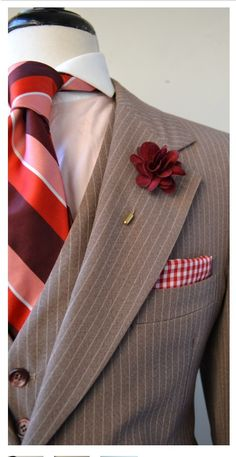 Beige pinstripe 3 pc suit accessorized with salmon,red & burgundy tie, burgundy boutonniere stick-pin, gingham lapel scarf & pale salmon shirt w/ white collar. Boutonnière can double as groomsman gift. Gentleman Mode, Gentleman Style, Three Piece Suit, 3 Piece Suits, Suit Up, Suit And Tie, Sharp Dressed Man, Well Dressed Men, Ideas Actuales