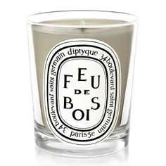 Diptyque Feu de Bois (Wood Fire) Candle is a very sophisticated blend of rare wood essences that evoke the characteristic fragrance of a wood-burning fireplace on a long winter day. A Diptyque top seller. Diptyque Bougie, Diptyque Candles, Scented Candles, Vanilla Candles, Homemade Candles, Patchouli Candles, Kwanzaa, Hannukah, Fragrance