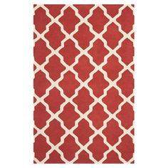 Hand-tufted wool rug with a trellis motif.  Product: RugConstruction Material: WoolColor: Rust a...