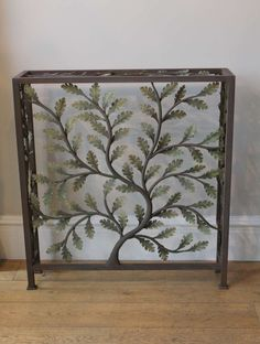 A custom made radiator cover based on the oak leaf design.
