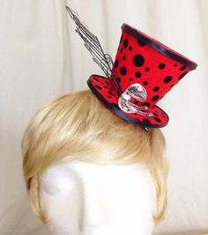 A personal favorite from my Etsy shop https://www.etsy.com/listing/236198325/lady-bug-red-and-black-feathered-mini