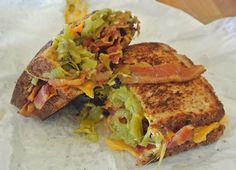 From the Mucho Gourmet Sandwich Shoppe in Santa Fe, New Mexico, this Southwestern Grilled Cheese hits the spot. It's Multi-Grain Bread (I like the kind with Sunflower Seeds in it), Cheddar Cheese, canned Green Chiles, and lots of crispy Bacon. Gotta have the Green Chiles in New Mexico...