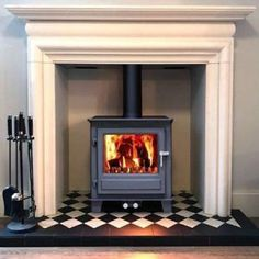 We are delighted to be the new Glasgow dealer for the Clock wood burning stoves. Electric Wood Burning Stove, Wood Burning Stove Insert, Insert Stove, Wood Burning Stoves, Stove Fireplace, Fireplace Design, Fireplace Ideas, Log Burner Living Room, Multi Fuel Stove