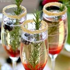 Blackberry Ombre Sparkler from The Cookie Rookie plus more christmas cocktails and holiday drinks on Frugal Coupon Living.