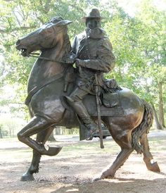 The equestrian statue of General James Longstreet is southwest of Gettysburg along West Confederate Avenue in Pitzer's Woods. (39.805726° N, 77.256549° W; map)