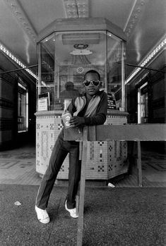 Boy in front of Harlem movie theater 1976