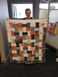 Omaha Modern Quilt Guild Visits AccuQuilt! This awesome Apple Core quilt was cut in 30 minutes!