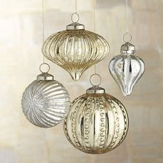 Reminiscent of early 20th-century designs, these beautiful ornaments are handcrafted in India of antiqued glass. Silver ball and finial ornaments have a dusting of glitter for a bit of sparkle. In gold, the onion ornament is textured with ridges and the ball striped with old-time hobnails. Topped with a traditional brass cap, the ornaments lend a nostalgic touch to the tree. Cluster in a bowl or hang on an ornament tree for a festive centerpiece or mantel display.