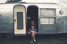 lonely girl in caravan