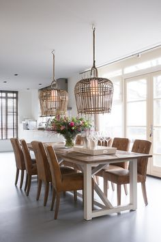 Wood + white.  I love the lights, and that the bulb is not bare.  Also intrigued by the hooks on the backs of the chairs