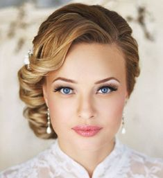 Bridal Makeup - I like how elegant this looks, without being overdone. Specifically, having mascara or shadow under my eyes tends to make them look small - this is a beautiful example of how to do that. Also, I love the front view of this hairstyle!!