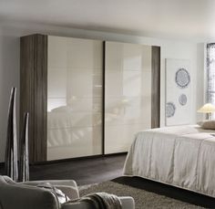 Rauch Xtend Sliding Wardrobe with Stripe - Havana Oak and High Polish Cappuccino