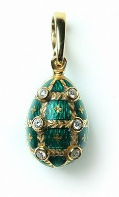 """FABERGE EGG CHARM European, 20th century. Gold with emerald green guilloche enamel and six bezel set diamonds with a hinged bail. Marked 18k Faberge and R 116/1000. 1.25"""" long including bail. 7.4g by Garth's Auctioneers & Appraisers"""