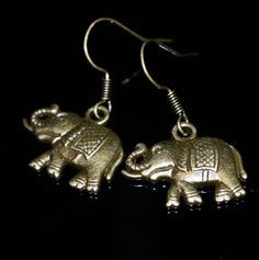 Hey, I found this really awesome Etsy listing at https://www.etsy.com/listing/212084945/bronze-elephant-charm-earrings-casual