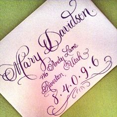 These pretty lavender envelopes were done in a slightly darker shade of lavender ink using our Platinum Flourish script. The guest name and zip code were done larger to make for a unique custom look. We also added a flourish underneath to top it off. Enjoy!