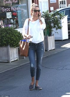 Easy breezy: Alessandra Ambrosio cut an elegant yet casual figure when she stepped out on ...
