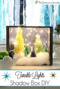 I saw a similar twinkle lights shadow box on Pinterest but thought it was too expensive so I managed to make one for half as much and I think it looks twice as good! Click through to see how easy it is to make!
