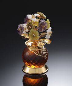 White jade, quartz and amethyst carved flowers. ROYAL INSIGNIA.
