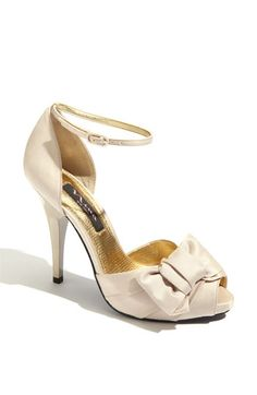Like other shoe but with strap, I like this one more probably. Available in gold and powder sand like the other one