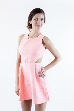 This coral cutout dress has flower embellishment all over.
