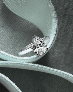 Pear-Shaped Diamond Engagement Ring. Change the plain band for a slender all diamonds and it would be perfect for me!