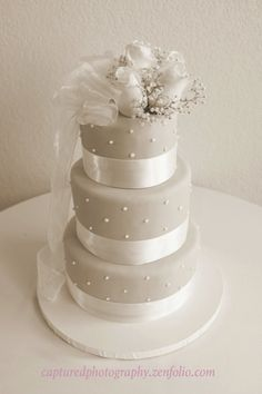 Simple Wedding Cake. Lavender/periwinkle flowers instead of white