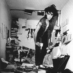 """""""Nick Cave spent much of the mid-1980s writing his first novel - And the Ass Saw the Angel. He would retreat to Berlin and immerse himself in the world of its protagonist, the deaf-mute Euchrid Eucrow. Like Eucrow, he decorated the walls of his retreat – a tiny closet in a prewar apartment – with tokens and fetishes, all the better to commune with his muse."""" ~Photographer Bleddyn Butcher"""