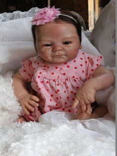 Coco Malu By Humble Hearts Nursery - This little one is so special!! She is created from the Coco Sculpt by Elisa Marx. This beauty has a soft cloth body that is super cuddly. Incredible hand micro rooted dark brown hair. Mohair by Delta Dawn, which is so super soft, it does not even require dampening(although you ma...