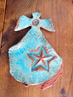 Artisan Pottery Cross... Rich Turquoise glaze drenched over a Terra Cotta clay body Fired Twice in the Kiln 8 1/2 tall, 6 wide sawtooth hanger