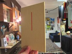 Upcycling hardcover books and turning them into canvas boards.
