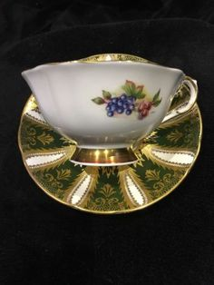 Paragon Tea Cup and Saucer Green with Gold Gilt and Fruit Centre