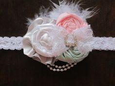 The perfect newborn headband. Tiny and petite for your little princess. Comes on a white stretchable lace headband in sizes newborn, 0-6, 6-12, 12-18, and 18-24 months. Can also be bought as a clip. Please leave size in the notes box when checking out. All orders ship within 3-5 days.