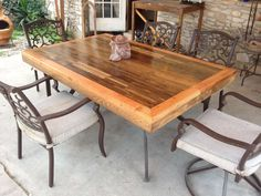 Patio Tabletop made from reclaimed deck wood     via instructables.com