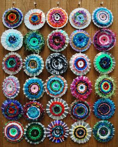 Recycle CDs by wrapping yarn around them and then have the kids weave with various styles, colors of yarn.  Think I'm going to get some more yarn!
