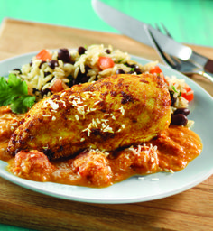 Spicy Brazilian Coconut Chicken - Clean Eating   Add some fire to your everyday chicken with this jalapeño- and ginger-infused coconut sauce from Brazil. Try serving it with brown rice and black beans.  (1 coconut chicken breast, 1/4 cup sauce, 1/2 tbsp coconut): Calories: 264,