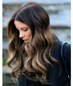 Medium brown hair with caramel and honey toned highlights.