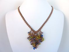 DIY Jewelry: FREE beading pattern for lovely V-shaped necklace made using coraling technique with 11/0 and 15/0 seed beads and multi-colored drilled chips. (1 of 3)