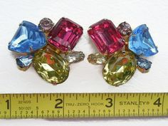Fun and bright for the lady who loves to sparkle! These measure about 1 1/2 across and 1 3/8 tall.Clips hold well without pinching. Great