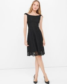 """The one dress that flatters all body types: the fit-and-flare. With its lush lace overlay and flirty off-the-shoulder neckline, you've got yourself a new LBD. There's still time to party, after all.   Black off-the-shoulder lace fit-and-flare dress  Elasticized shoulder straps Triple waist-defining details Invisible back zip with hook-and-eye closure Lined Approx. 39"""" from shoulder; hits at the knee Nylon/rayon/polyester/spandex. Machine wash cold. Imported"""