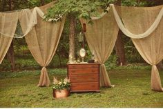 ooooohhhh!  Outdoor burlap curtains!  could make a very pretty frame for our covered patio!