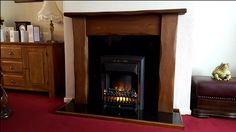 Sent in by Mr Northmore. The Waney Edge Straight Oak. Shown in a medium oak finish the Waney Edge Straight Oak shows off hand carved edges and a style unique to you alone. Oak Fire Surround, Living Room With Fireplace, Fireplace Surrounds, Solid Oak, Craftsman, Hand Carved, This Is Us, Rustic, Traditional
