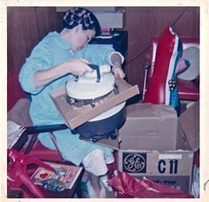 woman in curlers on Christmas opens vacuum vintage photo. I remember those slick synthetic robes: cold and the threads would pull easily. Ghost Of Christmas Past, Old Christmas, Old Fashioned Christmas, Retro Christmas, Christmas Morning, Christmas And New Year, Christmas Stuff, Vintage Christmas Photos, Christmas Pictures