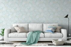 With soft shades of aqua and light blue, Plena Tranquil wallpaper by Patricia Braune will make any room a calm space. #surfacedesigner #interiordecor #bespokedecor #aqua #livingroom #sofa