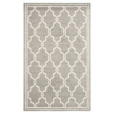 Anchor your living room seating group or define space in the den with this loomed rug, featuring a quatrefoil trellis motif for eye-catching appeal.