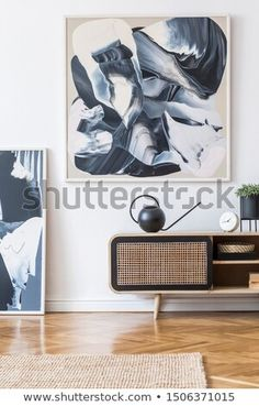 Stock Photo: Interior design of living room at nice scandinavian apartment with stylish commode, abstract paintings, tropical plant, books and elegant accessories. Modern home decor. Mock up. Scandinavian Apartment, Tropical Plants, Decoration, Interior Design Living Room, Stock Photos, Abstract Paintings, Modern, Minimalist, Template