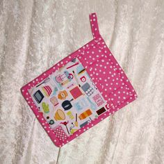 Handmade pot holder featuring designer fabric in retro kitchen icons on white and a coordinating hot pink pattern adds fun to your kitchen.