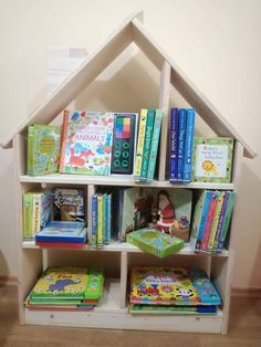 Items similar to Bookcase House Shaped / Bookshelf kids / Wooden handmade / Montessori / Kids room on Etsy Handmade Bookshelves, Animal Doodles, Animals Of The World, Kidsroom, Wood Colors, Natural Wood, Bookcase, Shapes, Handmade Gifts