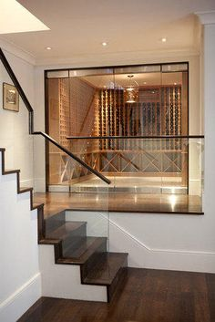A 1913 Edwardian Home Becomes a Modern Masterpiece Instead of stowing a wine collection in an underground cellar, why not artfully display i. Houses Architecture, Interior Architecture, Underground Cellar, Home Wine Cellars, Wine Cellar Design, Wine Cellar Modern, Escalier Design, Loft, Wine Collection