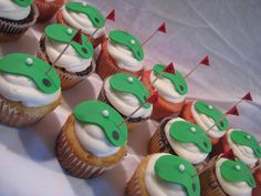 """""""These were for a birthday boy who loves to golf! I took inspiration from the many golf cupcakes on CC. The cupcakes were strawberry, marble, and yellow cakes with vanilla buttercream. The greens, golf balls, and cups are fondant. The flags are cardstock with toothpicks as the pole."""""""