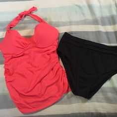 Two piece swimsuit from Victoria Secrets The top is a slim fitting ruche tankini top with halter straps. Size 36D , melon in color. The bottoms are a high waisted and black in color, Size Large. In excellent condition , smoke and pet free... Victoria's Secret Swim Bikinis